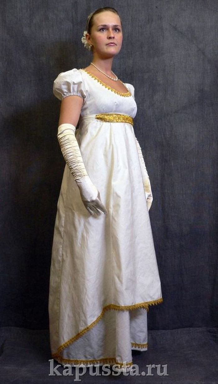 Dress white with a gold belt