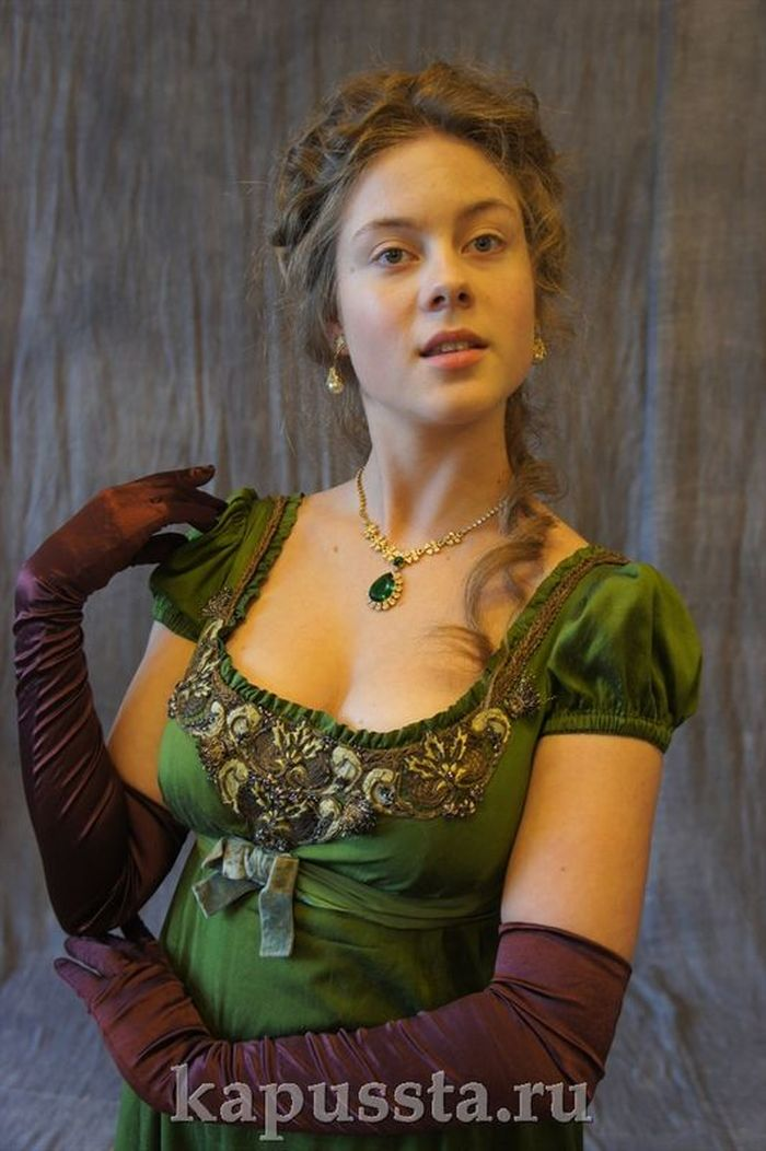 Green dress with antique trim