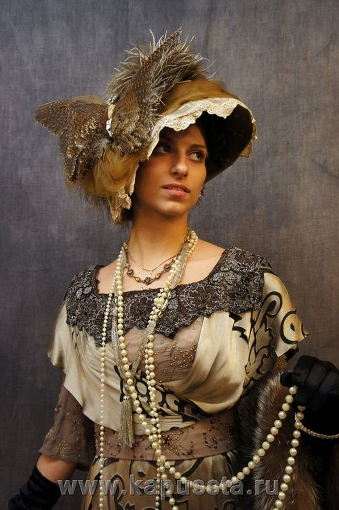 Dress with antique decoration and a butterfly hat