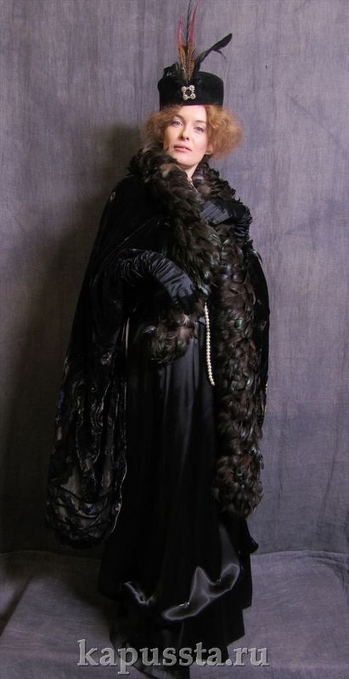 Black cape with Boa era Modernism
