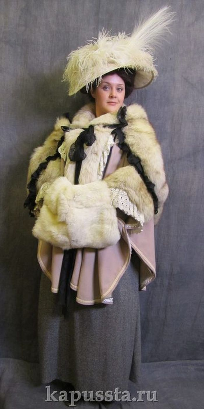 Lilac cape with trim and boa