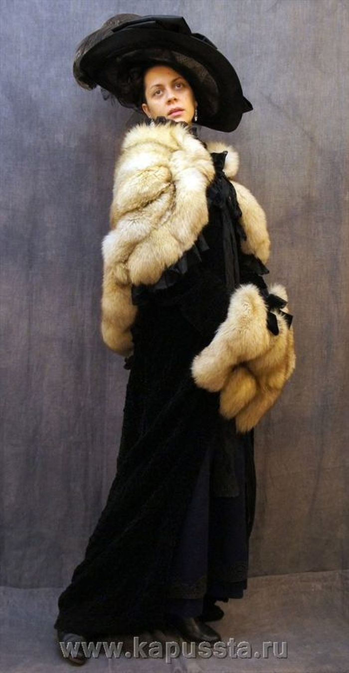 Winter women's clothing with a hat of the modern era
