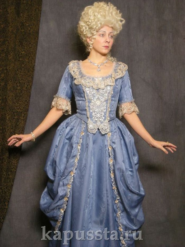 Blue dress with embroidery in a wig