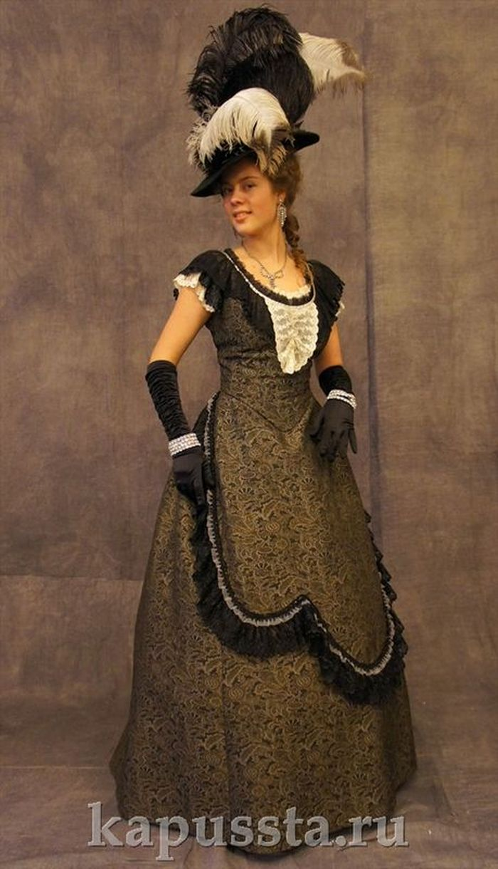 Ballroom dress of the 19th century with bonnet and feathers