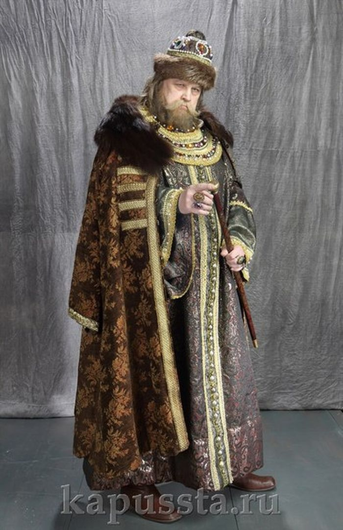 The royal costume with a baton